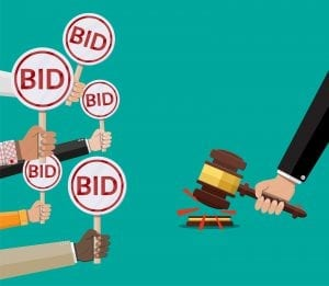 Hands holding out bid signs for pay-per-click advertising