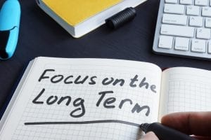 """Notebook with """"Focus on the Long Term"""" written."""