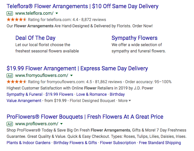 Search results paid ads showing how to optimize for negative keywords for flower arrangement