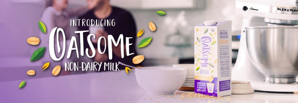 Oatsome Oat Milk on counter with bowl and mixer