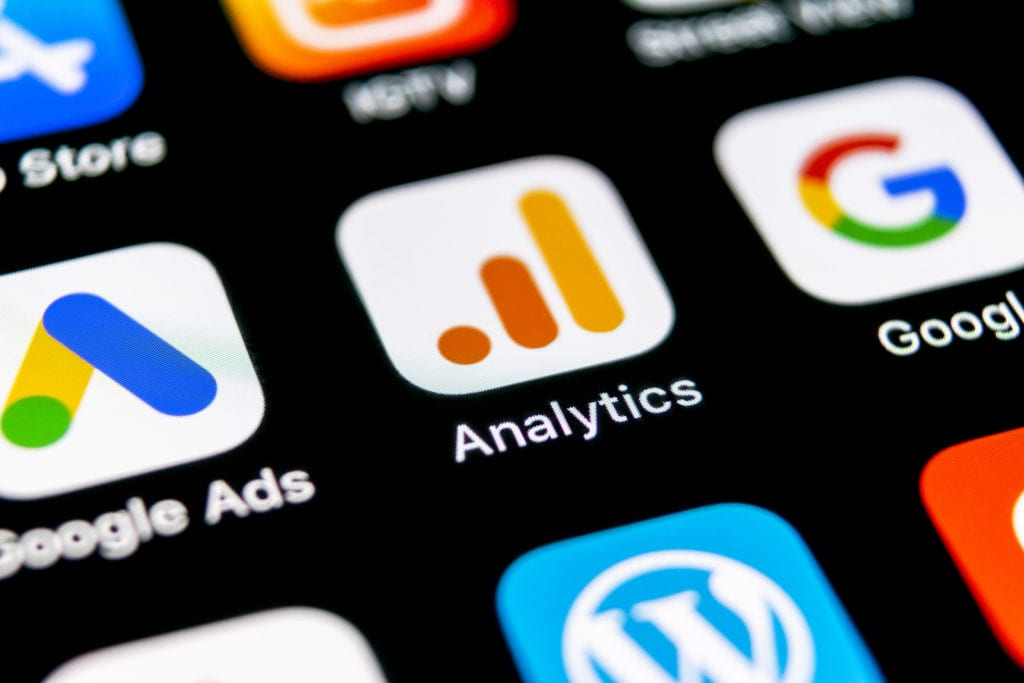Google Analytics and Google Ads apps on mobile device screen