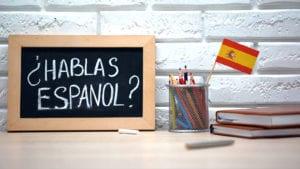 hablas espanol on chalkboard to learn to write a website in spanish