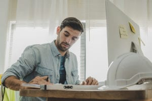 young male contractor working on seo